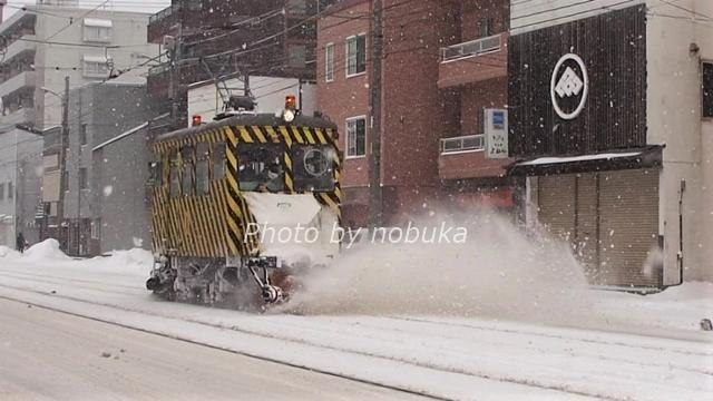除雪中の札幌市電ササラ電車